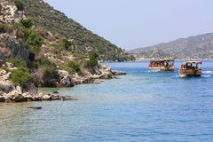 Along the shore. Sightseeing tour on yachts along the coast of the Mediterranean Sea Royalty Free Stock Images