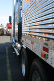 Along side. Long side view of tractor trailer stock photography