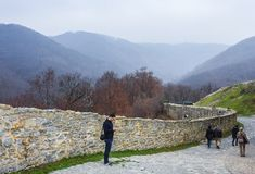 Along the wall. People walk along the wall on the mountain Stock Photography