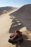 Along the way. Dune and shoes in Singing Sands Mountain gansu province in China Stock Photography
