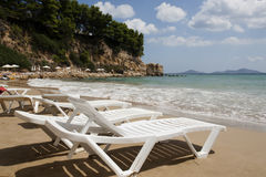 Alonissos - Beach chairs on sandy beach. Royalty Free Stock Photography