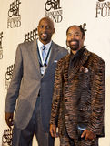 Alonzo Mourning and Walt. Retired former NBA all-stars, Alonzo Mourning and Walt 'Clyde' Frazier, arrive on the red carpet for the Buoniconti Fund's 27th Annual Royalty Free Stock Photo