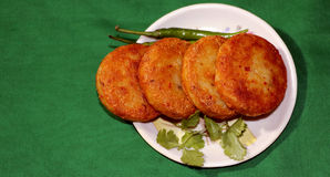 Aloo Tikki or Fried Potato Patties. A popular Indian snack served with tomato and chilli sauce Royalty Free Stock Images