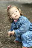 Aloof Girl. Exploring the ground while at the park stock image