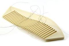Alopecia con la spazzola per i capelli bianca Fotografia Stock