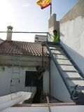 Men handeling steel staircase. Alora, Spain - December 15, 2011: Men lifting steel staircase into position in village house, Andalusia Royalty Free Stock Image