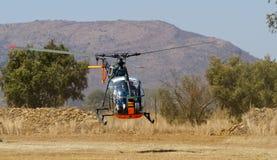 Alouette II at Nyoka ridge. NYOKA RIDGE, SOUTH AFRICA-1 SEPTEMBER 2012-A ex-SAAF Alouette II takes off to video proceedings at the International Vulture Stock Images