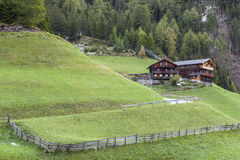 Alp farm on a slope Royalty Free Stock Photo