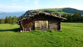 Alp lodge. Wooden alp lodge on the Seiseralm within a beautiful panorama royalty free stock photography