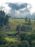 Alp met het opheffen van mist Stock Foto