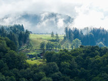 Alp with raising fog Royalty Free Stock Images