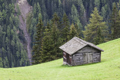 Alp shed on a slope Royalty Free Stock Images