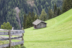 Alp shed on a slope Royalty Free Stock Photo