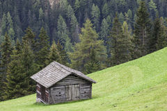 Alp wood shed on a slope Royalty Free Stock Images