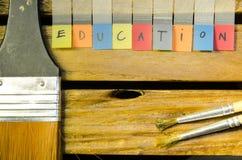 Alpabet da educação com escova fotografia de stock royalty free