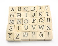 Alpabet from home made blocks. Home made wooden blocks show the entire alphabet Royalty Free Stock Photos