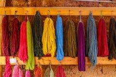 Colourful Alpaca Wool, drying on the wall, Peru stock photo