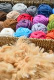 Alpaca wool balls and fleece Stock Image