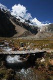 Alpamayo, Andes. Icy peak and mountain stream. White Cordilleras, Peru Royalty Free Stock Image