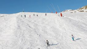 Skiing down the slopes stock footage