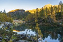 Alpe devero autumnal mountain landscape. Sunrise over the Lake of the witches inside the Alpe Devero flat land stock image