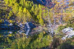 Alpe devero autumnal mountain landscape. Sunset over the Lake of the witches inside the Alpe Devero flat land royalty free stock photo
