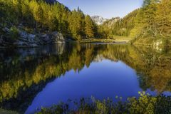 Alpe devero autumnal mountain landscape. Sunset over the Lake of the witches inside the Alpe Devero flat land stock images
