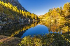 Alpe devero autumnal mountain landscape. Sunset over the Lake of the witches inside the Alpe Devero flat land stock image