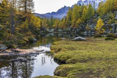 Alpe devero autumnal mountain landscape. Sunset over the Lake of the witches inside the Alpe Devero flat land stock photography