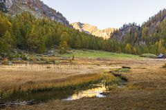 Alpe devero autumnal mountain landscape. Sunset over the Lake of the witches inside the Alpe Devero flat land stock photo