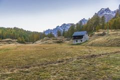 Alpe devero autumnal mountain landscape. Sunset over the Lake of the witches inside the Alpe Devero flat land royalty free stock photography