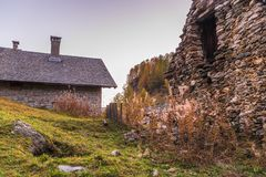 Alpe devero autumnal mountain landscape. Sunset over a small village inside the Alpe Devero flat land royalty free stock image