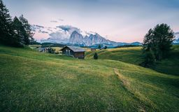 Alpe di Siusi Seisser Alm. Meadows and traditional old mountain chalets Stock Image