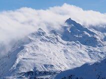 Alpejski szczyt w chmurze Obraz Royalty Free