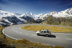 Alpen Drive. Alpen high mountains  road with family car Royalty Free Stock Image