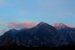 Alpen. Full moon visible at sunset in Alpen Italian part stock image