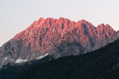 Alpen glow across a mountain range in bavaria. Alpen glow across a mountain range Royalty Free Stock Image