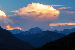 Alpen glow across a mountain range in bavaria Royalty Free Stock Image