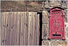 Alpen house in the north of italy. Alpen elements in autumn, an house with a red post service, and a daily service of delivery of the post office stock photo