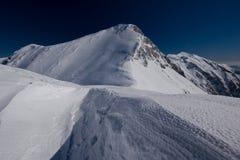 Alpen im Schnee Lizenzfreie Stockfotos