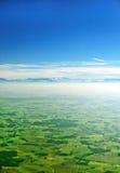 Alpen und Ackerland in Deutschland Stockfotografie