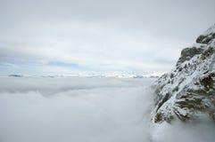 Alpen in Wolken Royalty-vrije Stock Afbeeldingen