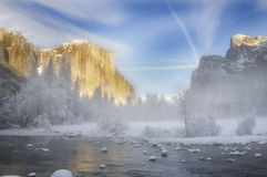 Alpenglow on the granite peaks in Yosemite valley. With mist rising above the merced river Royalty Free Stock Photo