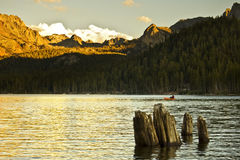 Alpenglow at Lake Mary. I was fishing and I had my camera set up on a tripod as the sun went down.   The sun was at the perfect angle to cast some alpenglow on Stock Photography