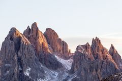 Alpenglow. Mountain peaks in alpenglow in dolomites Royalty Free Stock Images