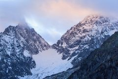 Alpenglow on the mountain. Snowcapped peaks Royalty Free Stock Images