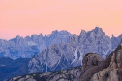 Alpenglow mountains. Mountain peaks in alpenglow in dolomites Stock Photos