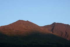 Alpenglow on Mountains near Seward, Alaska Royalty Free Stock Image