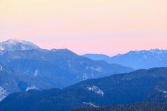 Alpenglow over alps. Mountain peaks in alpenglow in alps Royalty Free Stock Image
