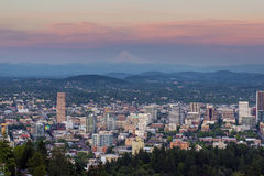 Alpenglow over Portland Oregon Cityscape sunset. Alpenglow over Mount Hood and cityscape of downtown Portland Oregon after sunset Royalty Free Stock Photo
